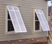 Bahamas style shutters from John's Shutters and Repair look like wood, are made of strong extruded aluminum custom made to the size you need.