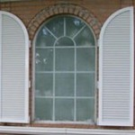 Colonial style storm shutters from John's Shutters and Repair are attractive and provide instant protection from storms and hurricane force winds.
