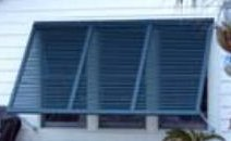 Bahamas style storm shutters from Johns's Shutter and Repair provide excellent protection from high wind and storms, provide excellent heat and ligh control and are custom made to fit the opening you want to protect.