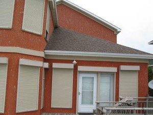 Rolling shutters from John's Shutter & Repair protecting a home on Galveston Bay